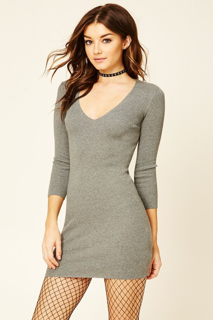 A ribbed knit mini dress featuring a V-neckline, a fitted silhouette, and 3/4 sleeves.