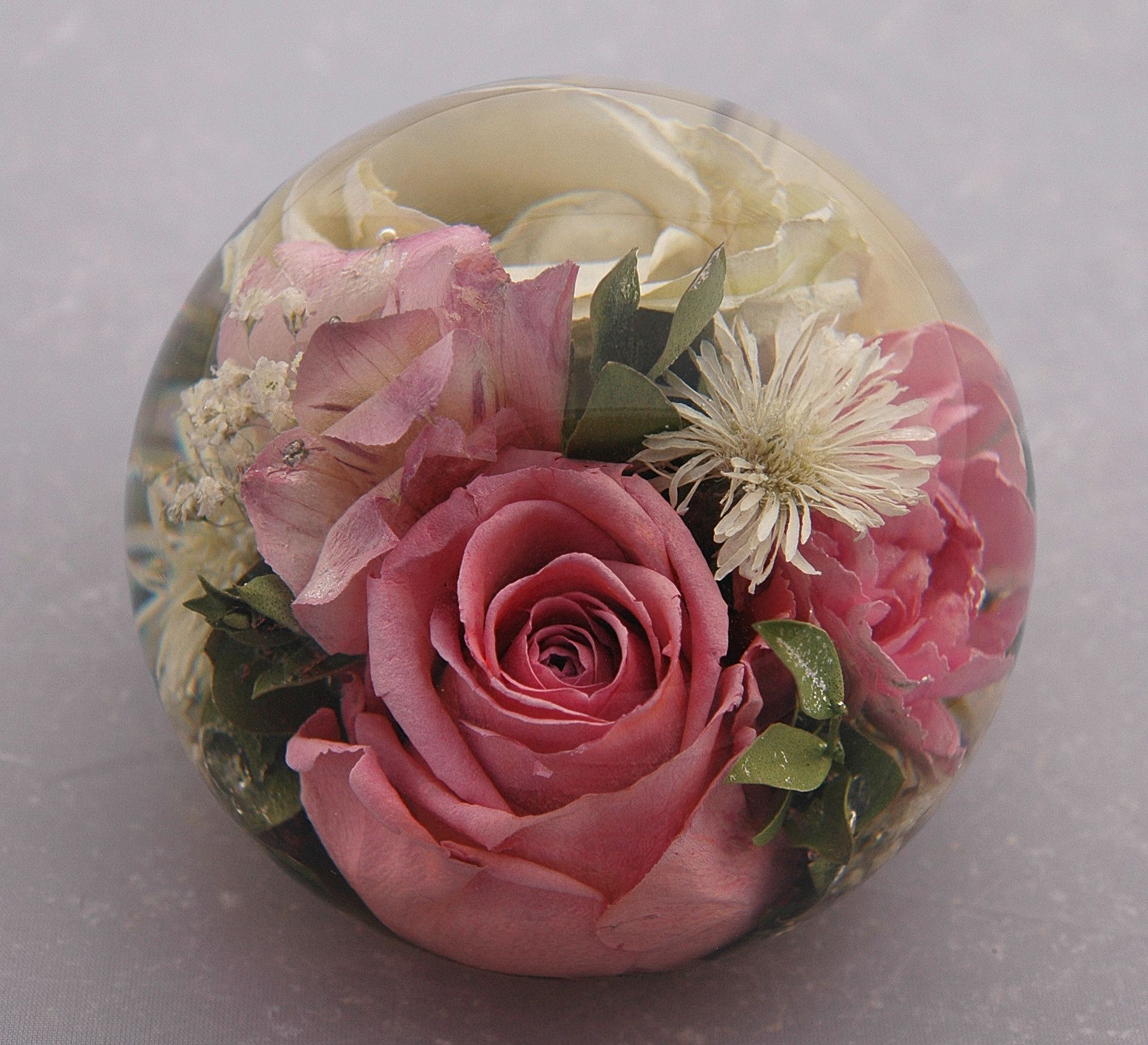 Flowers preserved within paperweights from £139.95