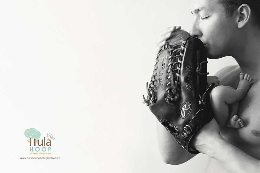 Newborn and parents baseball
