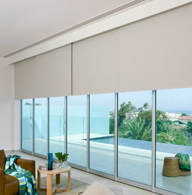 These roller blinds have been installed behind a pelmet to hide all the mechanisms and create a clean look  Windows  Sliding door blinds Blinds