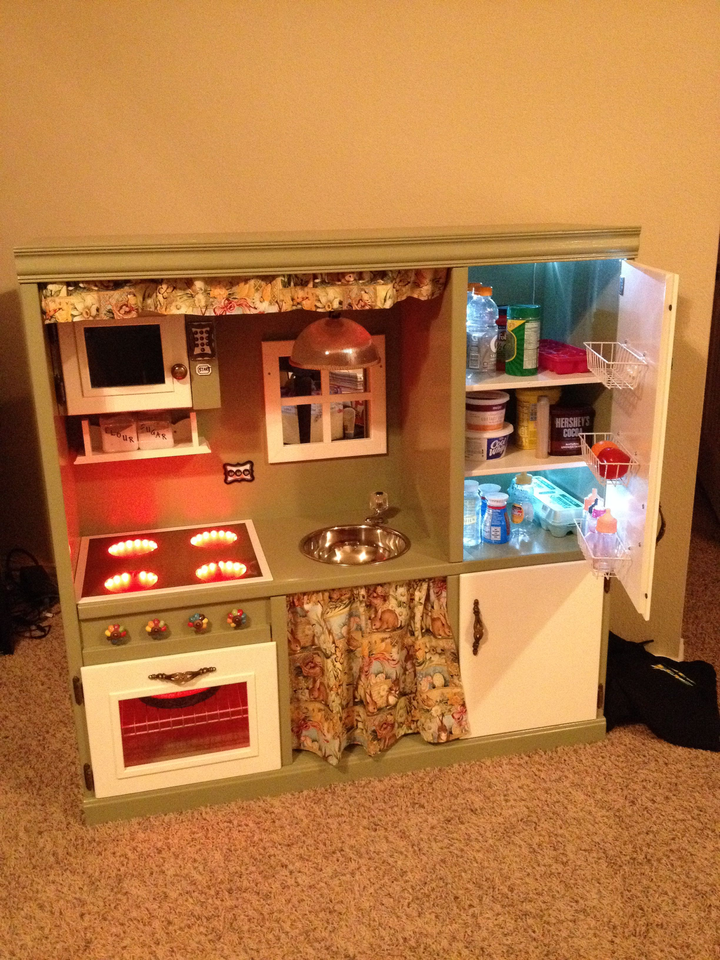 Play kitchen made from used entertainment center ️ Diy