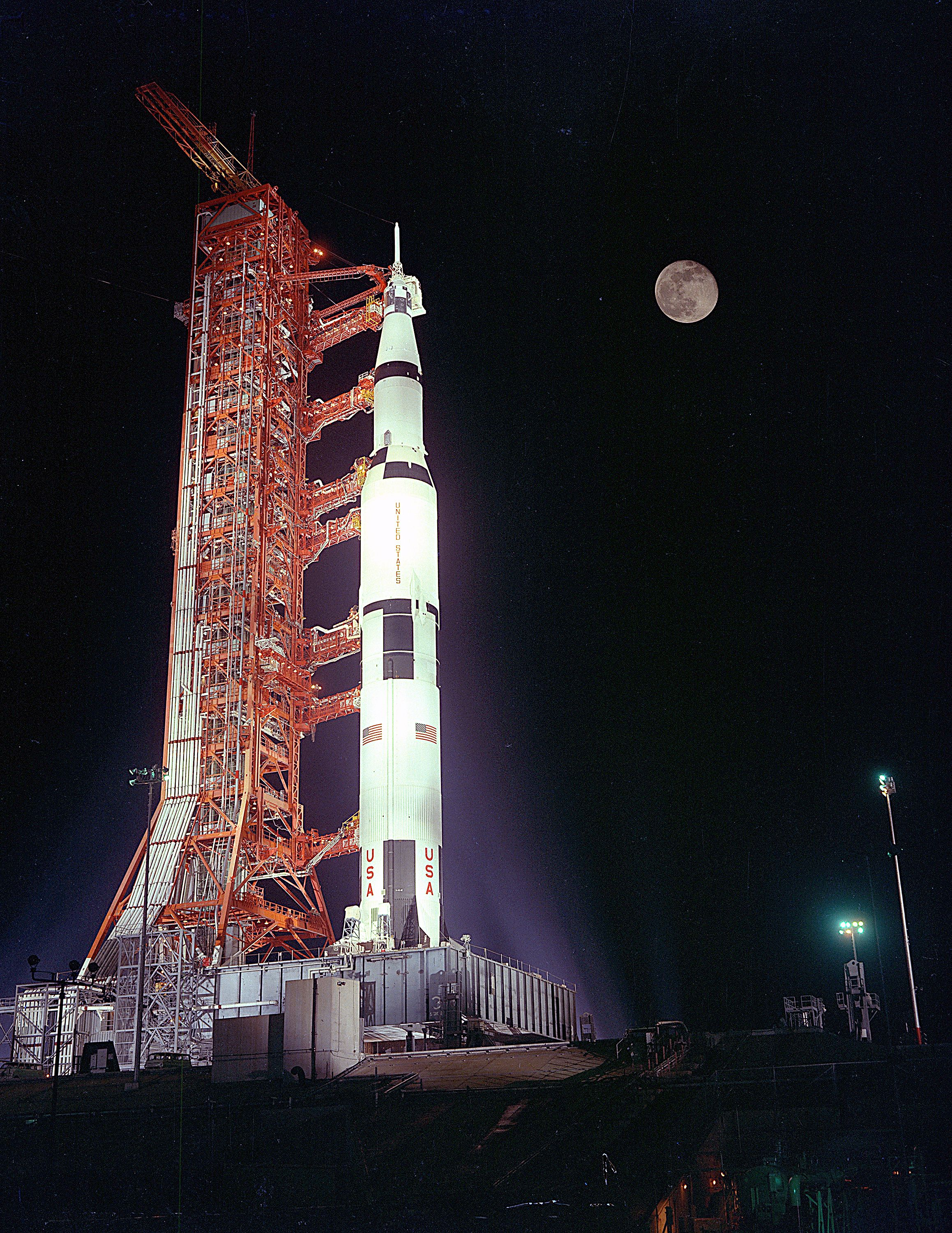 The Apollo 17 Space Vehicle sits poised beneath a full