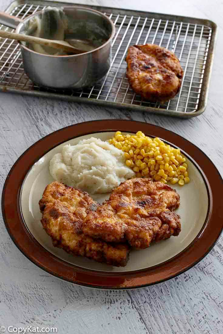 The best Southern fried chicken that's crispy on the outside and moist on the inside. Learn the secret to Cracker Barrel Sunday Homestyle Chicken and make it at home with this easy copycat recipe. #friedchicken #chickendinner #southernfood #dinnerideas #dinnertime #copycat #copycatrecipes