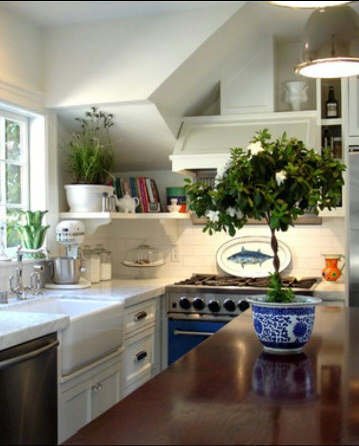 Blue Stove!! White tile, white counters, mixed with dark countertop island