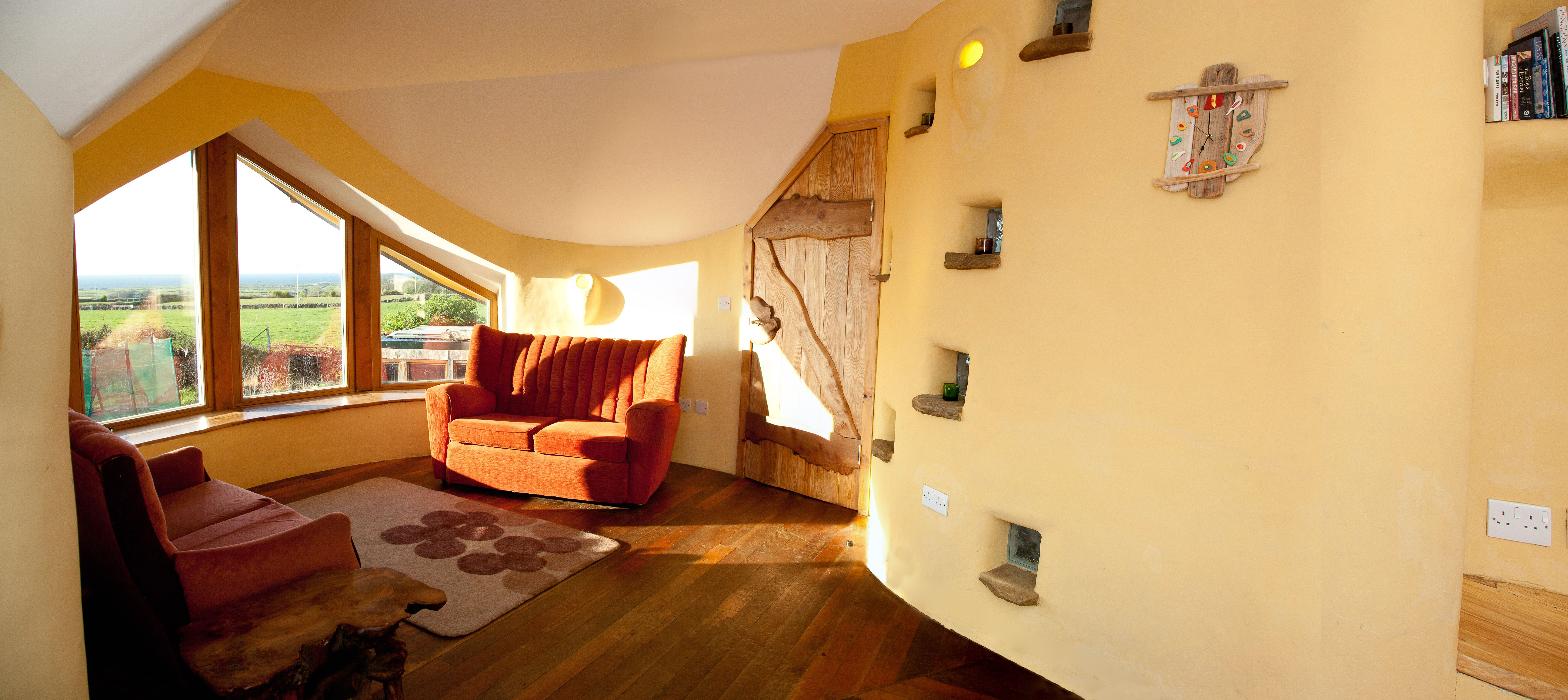 The Sunset Lounge In The Mud And Wood House   The Curved Walls Are All Made  From Cob   A Mixture Or Mud And Straw.