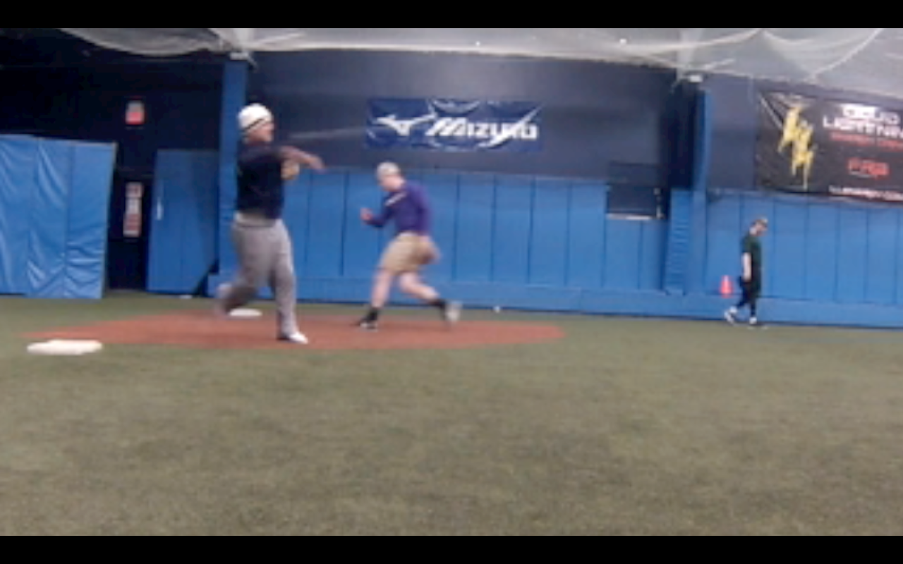 Infield work at an open workout for college players; January 2013