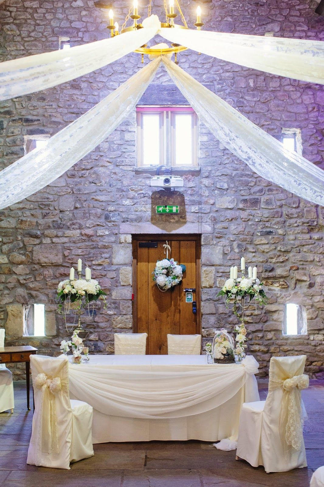 The scene was set in the fabulous tithe barn at browsholme hall with the beautiful wedding of emma james at browsholme hall tithe barn featuring some beautiful images from lottie designs izmirmasajfo