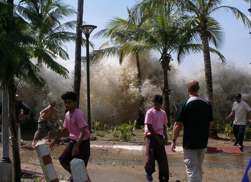 From Ten Years Since the 2004 Indian Ocean Tsunami, one of 34 photos.  Seawater splashes in the air as the the first tsunami waves hit Ao Nang, ...