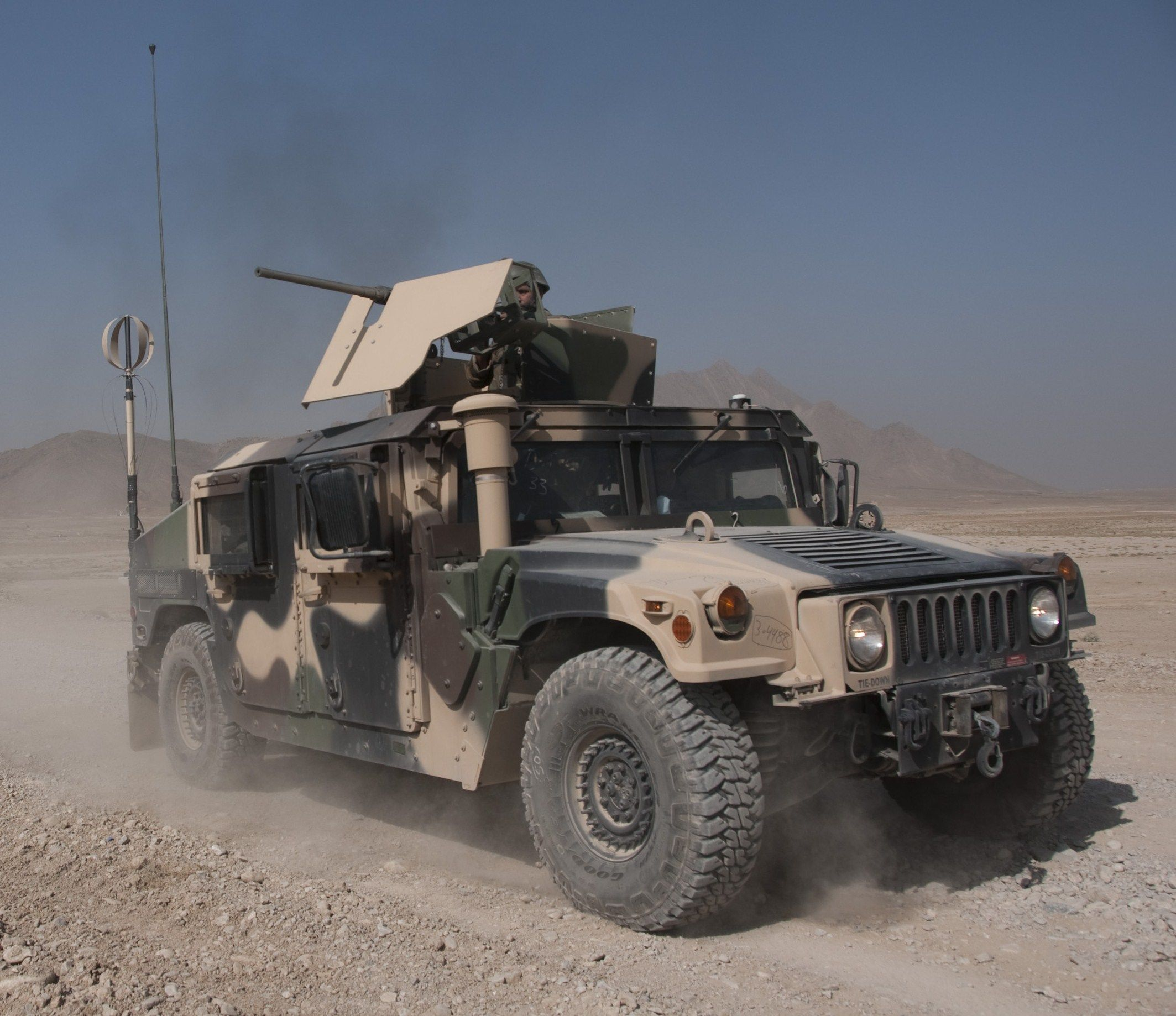 Humvee with mounted machine gun turret