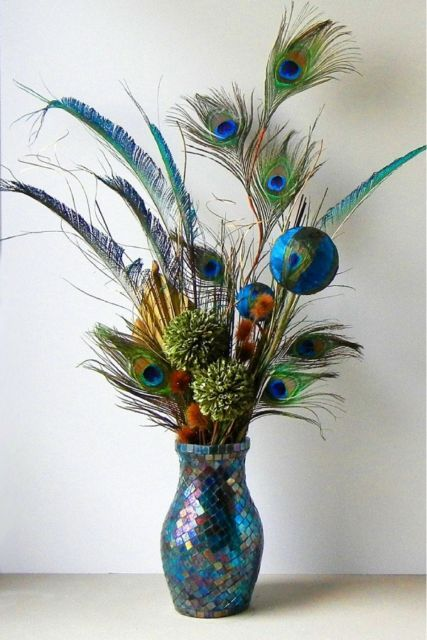 Artificial flower arrangement peacock feathers mirror vase