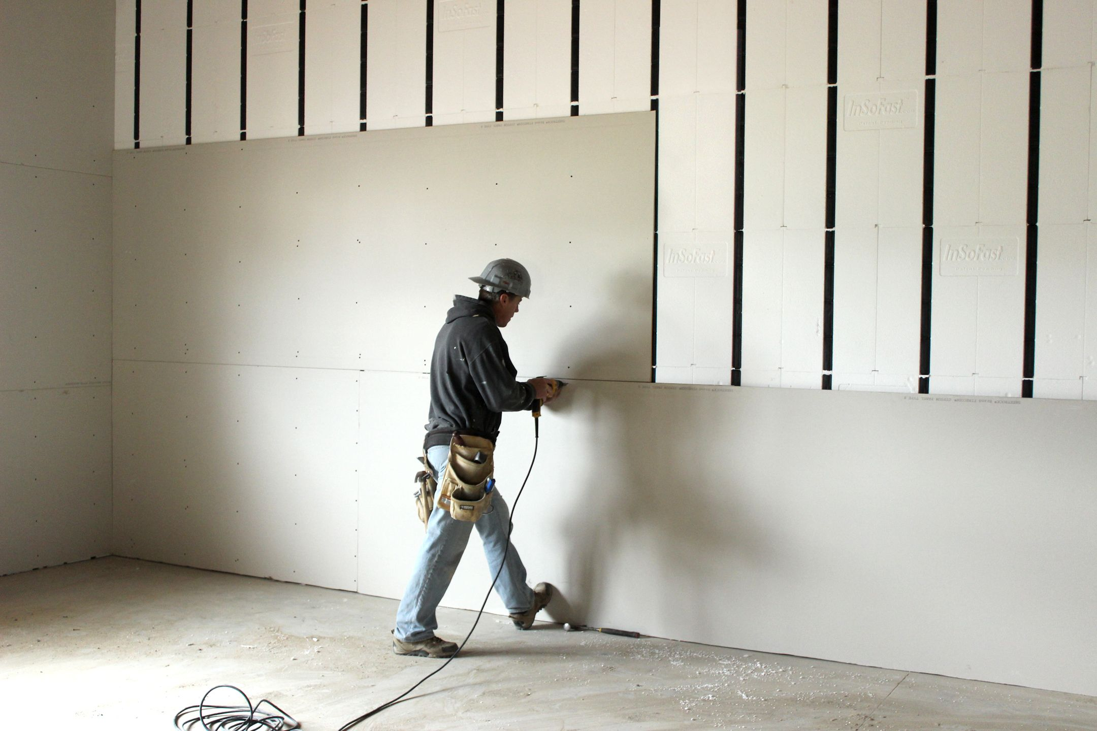 Drywall Contractors In Boston Ma Hanging Sheetrock Or Drywall Is Important Because Very Often It Repres Drywall Installation Drywall Basement Foam Insulation