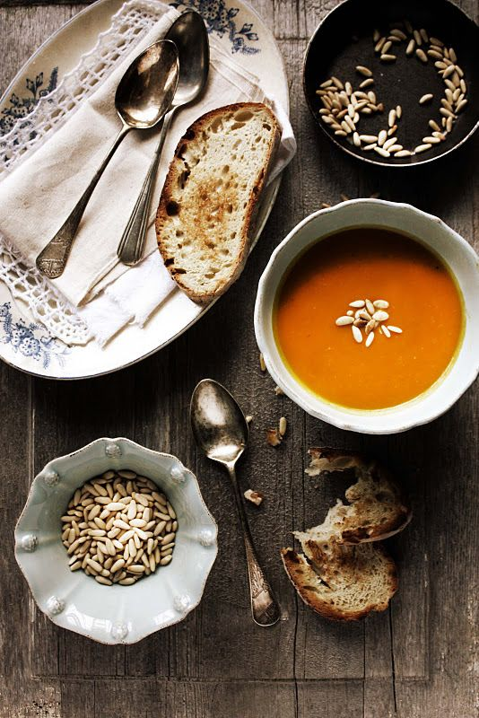 Roasted vegetables soup with rosemary and pine nuts
