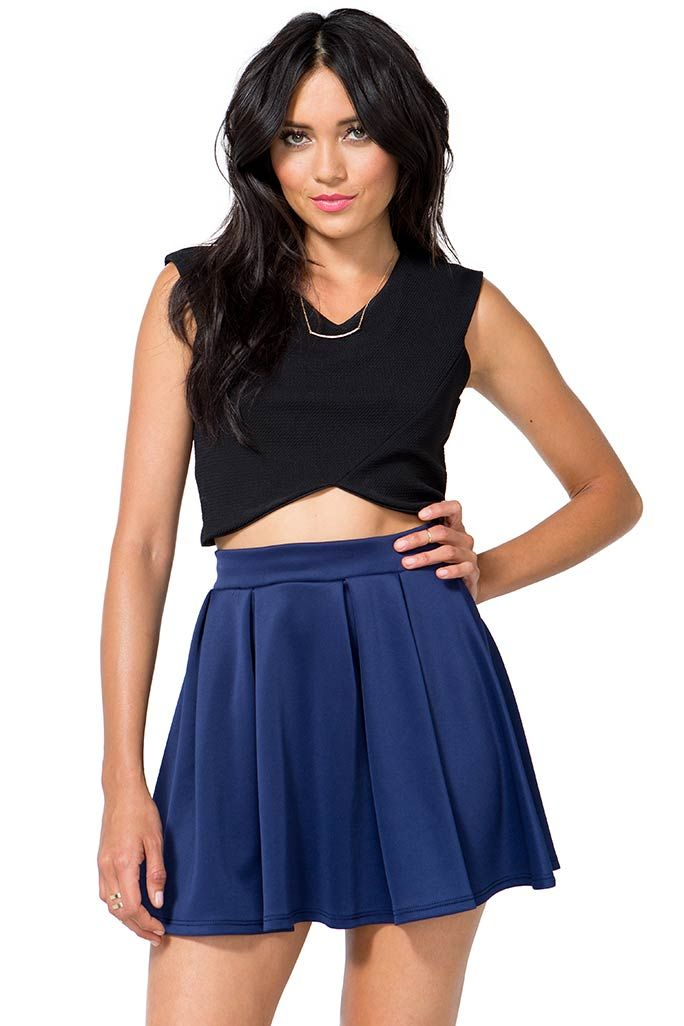 d8499f1a6d Make 'em holler in this flirty flare! A scuba knit skater skirt featuring  box pleating and an elasticized waist. Finished short hem.