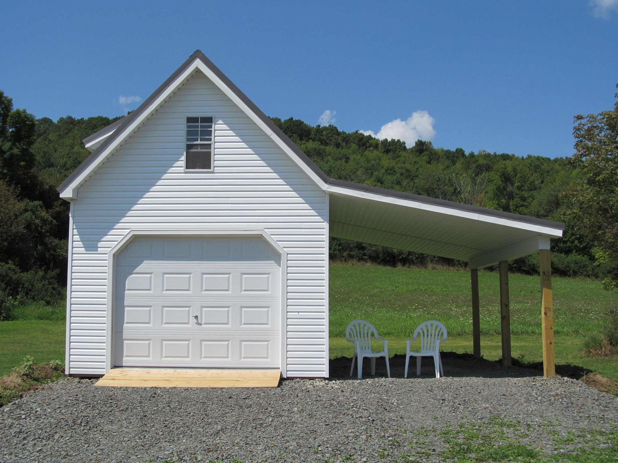 Singlewide garage with a dormer and an overhang garages for Garage overhang