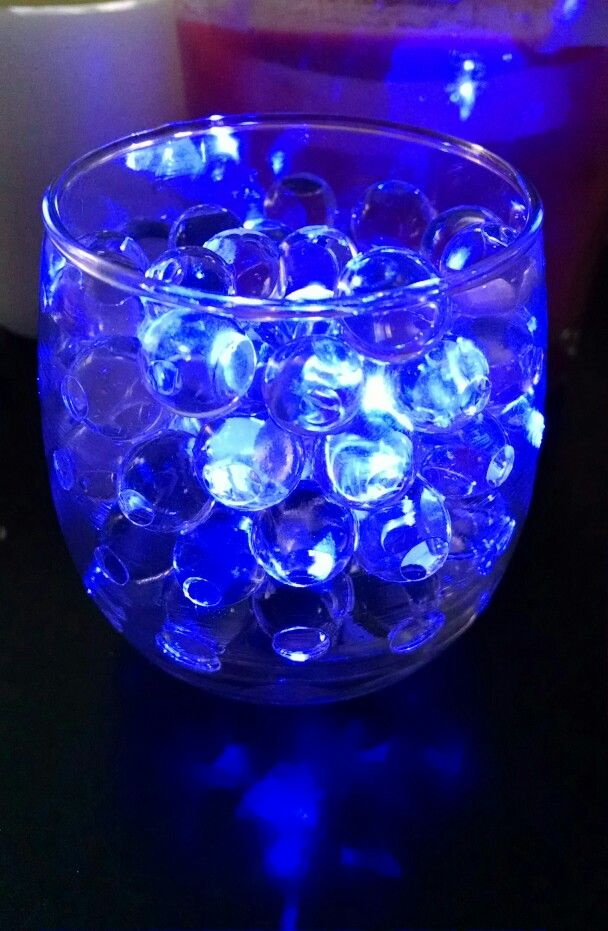 Clear water beads with blue LED submersible tea light. Really pretty for  wedding table centerpieces