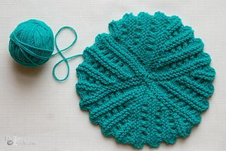 This beautiful coaster/ dishcloth is knitted using ...