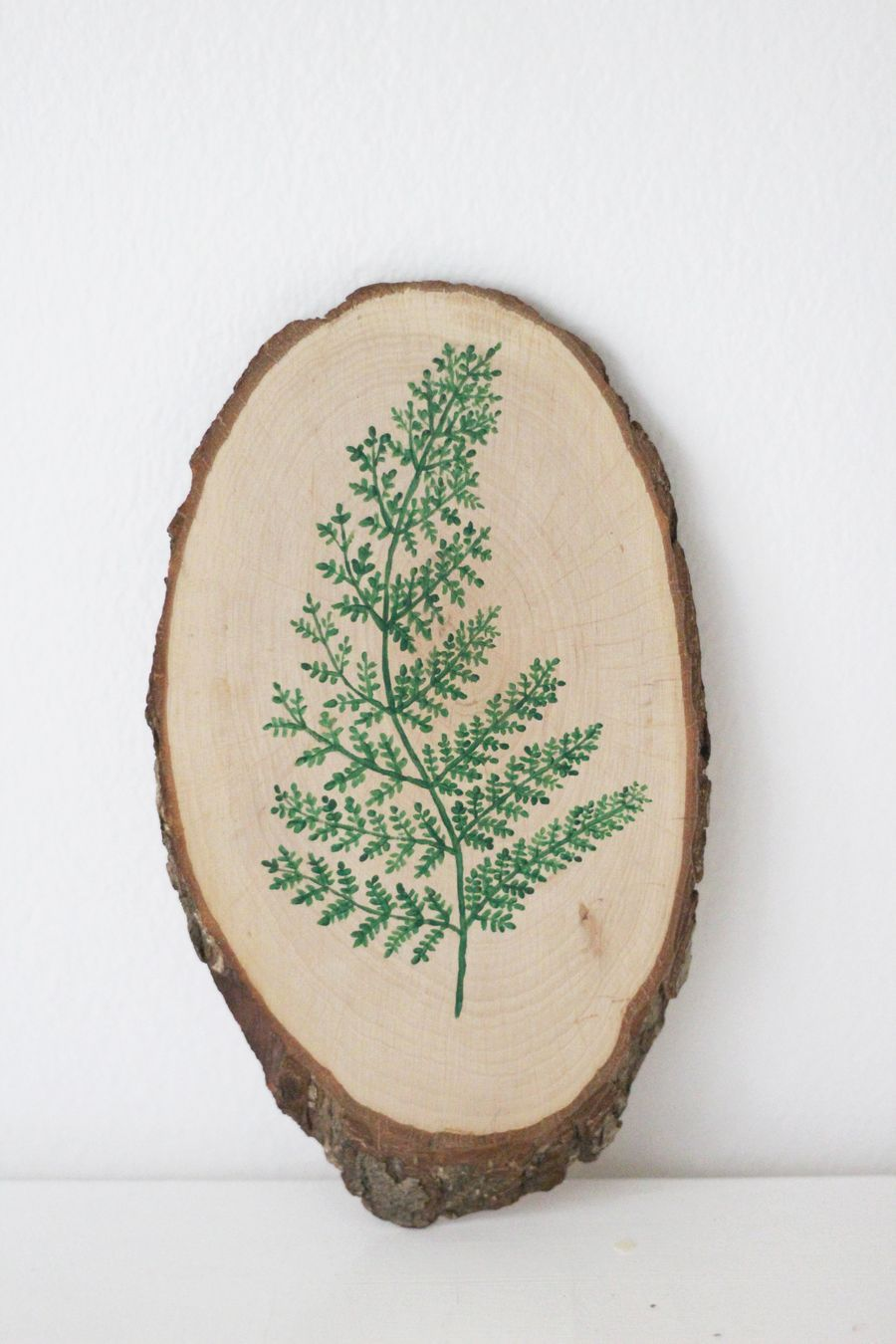 DIY painted fern on piece of wood