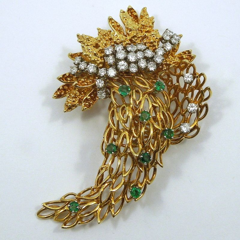18K Yellow Gold Cornucopia Inspired Spray Style Pin with Emeralds & Diamonds. Approximately 1.86 Total Carats of Diamonds and 0.37 Carats of Emeralds. The Diamonds are VS2 in Clarity and G-H in Color. - $1,800