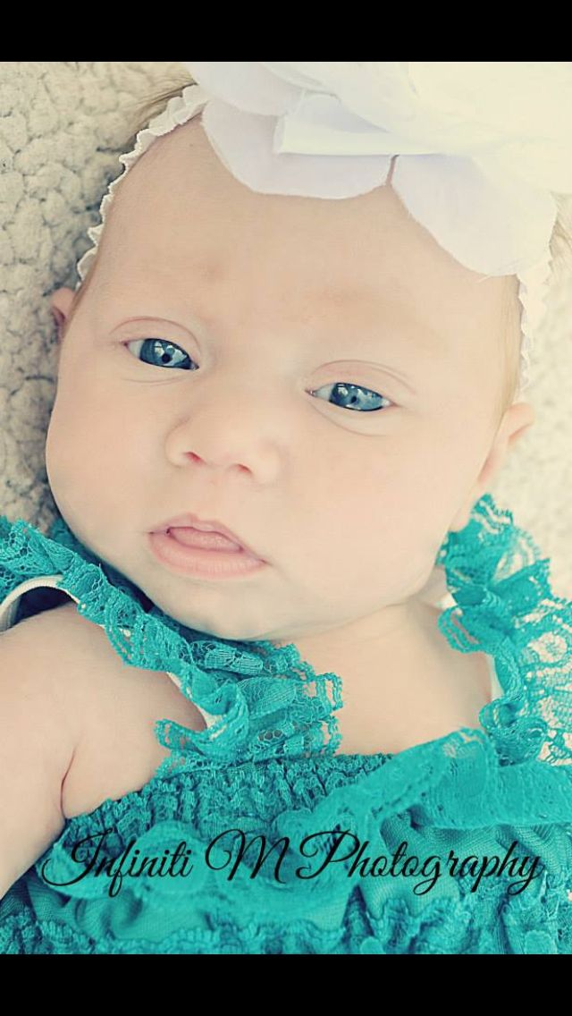 1 month old baby girl lace romper white bow blue eyes outside photoshoot