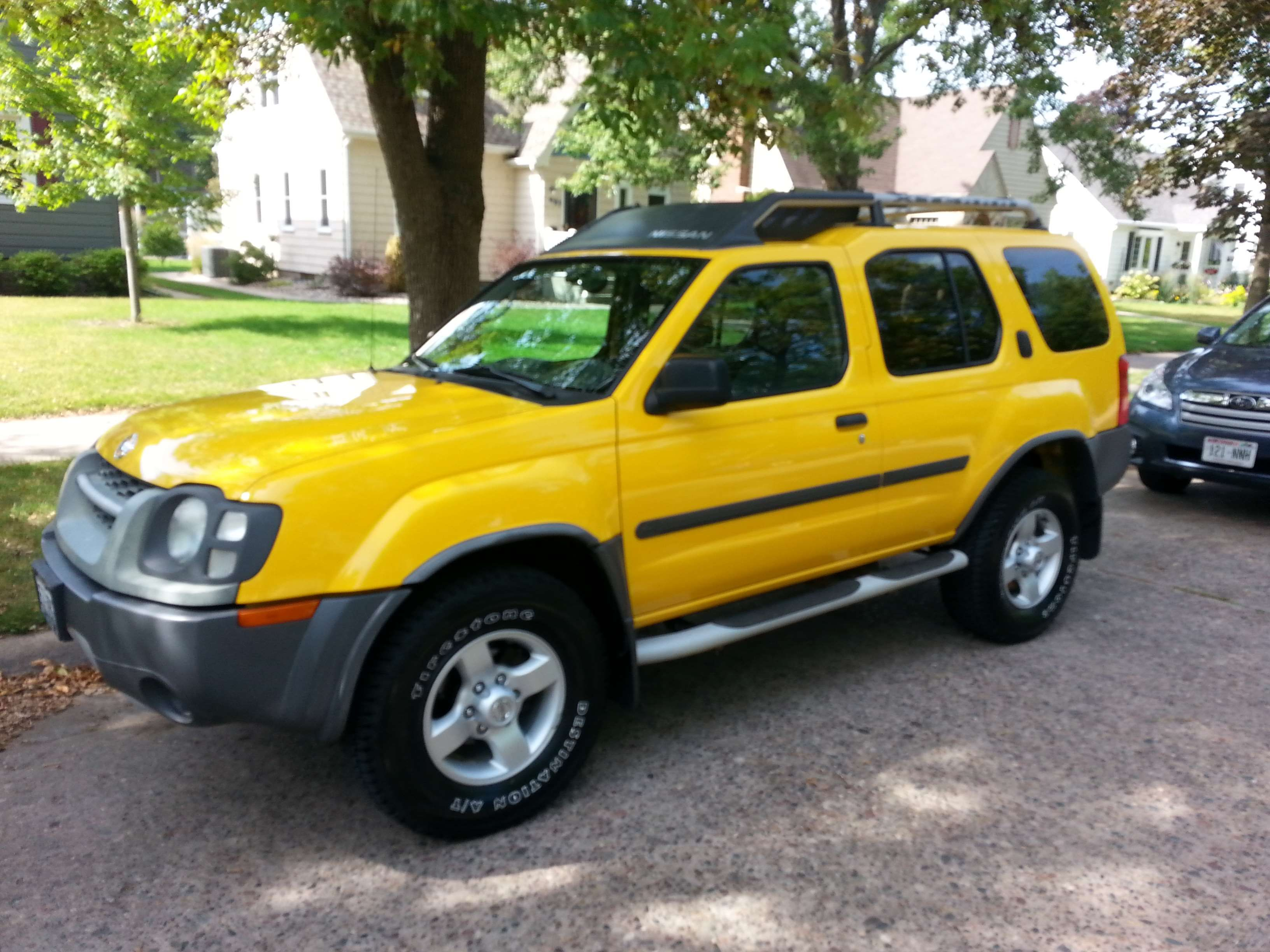 Make: Nissan Model: Xterra Year: 2004 Exterior Color: Yellow Interior Color: