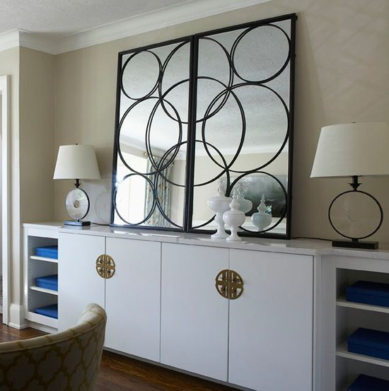 While it looks custom-made, the cabinetry is actually stock from Ikea, gussied up with a Carrara marble top and Chinese-influenced hardware.