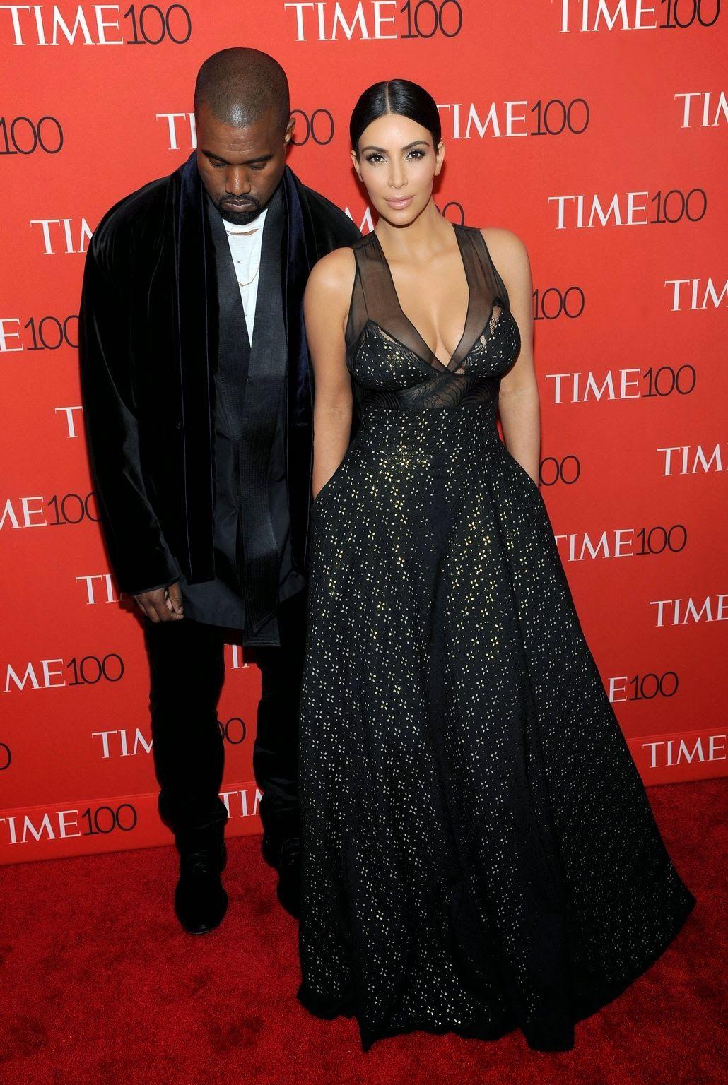 Kim kardashian bares cleavage alongside kanye west at the time