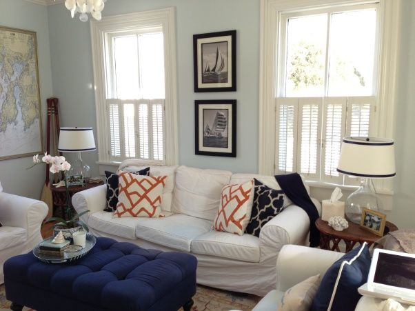 i like the simplicity of the white furniture with navy accents and