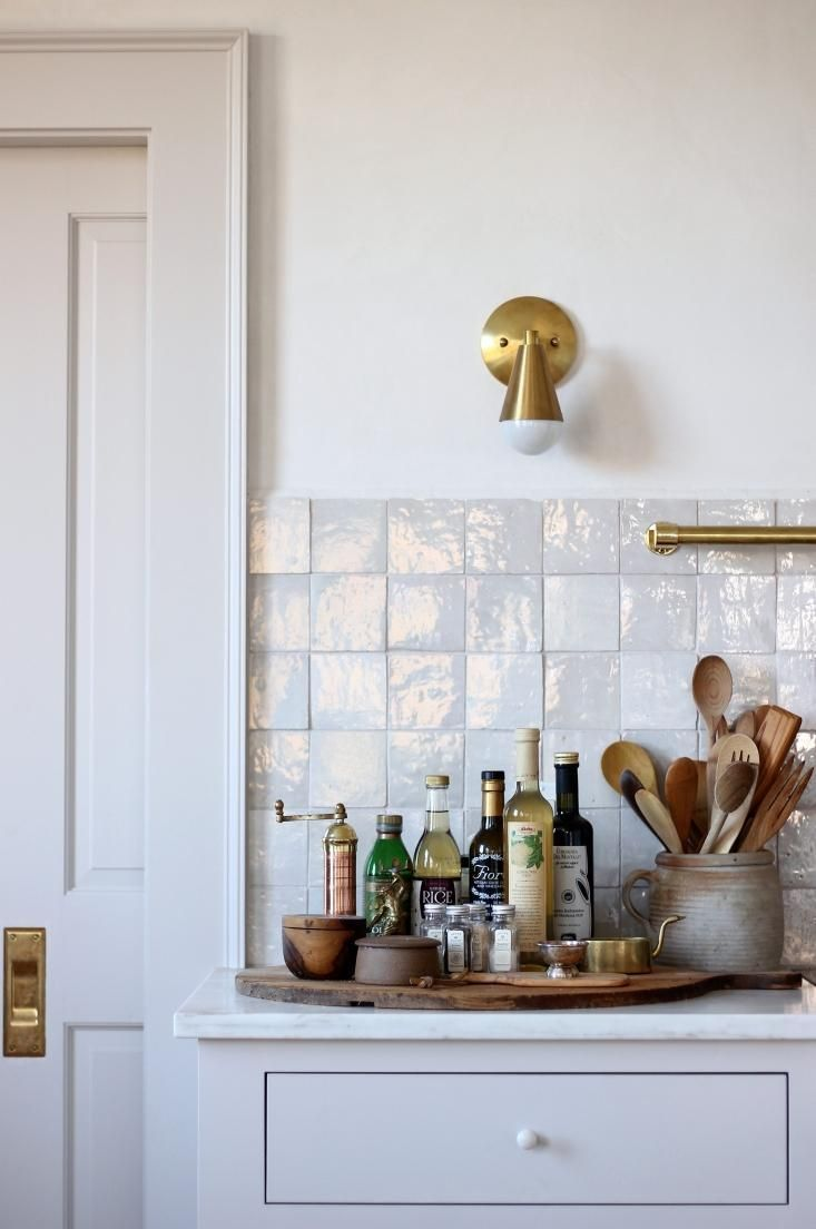 New house remodel in maine by jersey ice cream co glam eat in kitchen with glazed tile backsplash in maine house designed by jersey ice cream co dailygadgetfo Choice Image