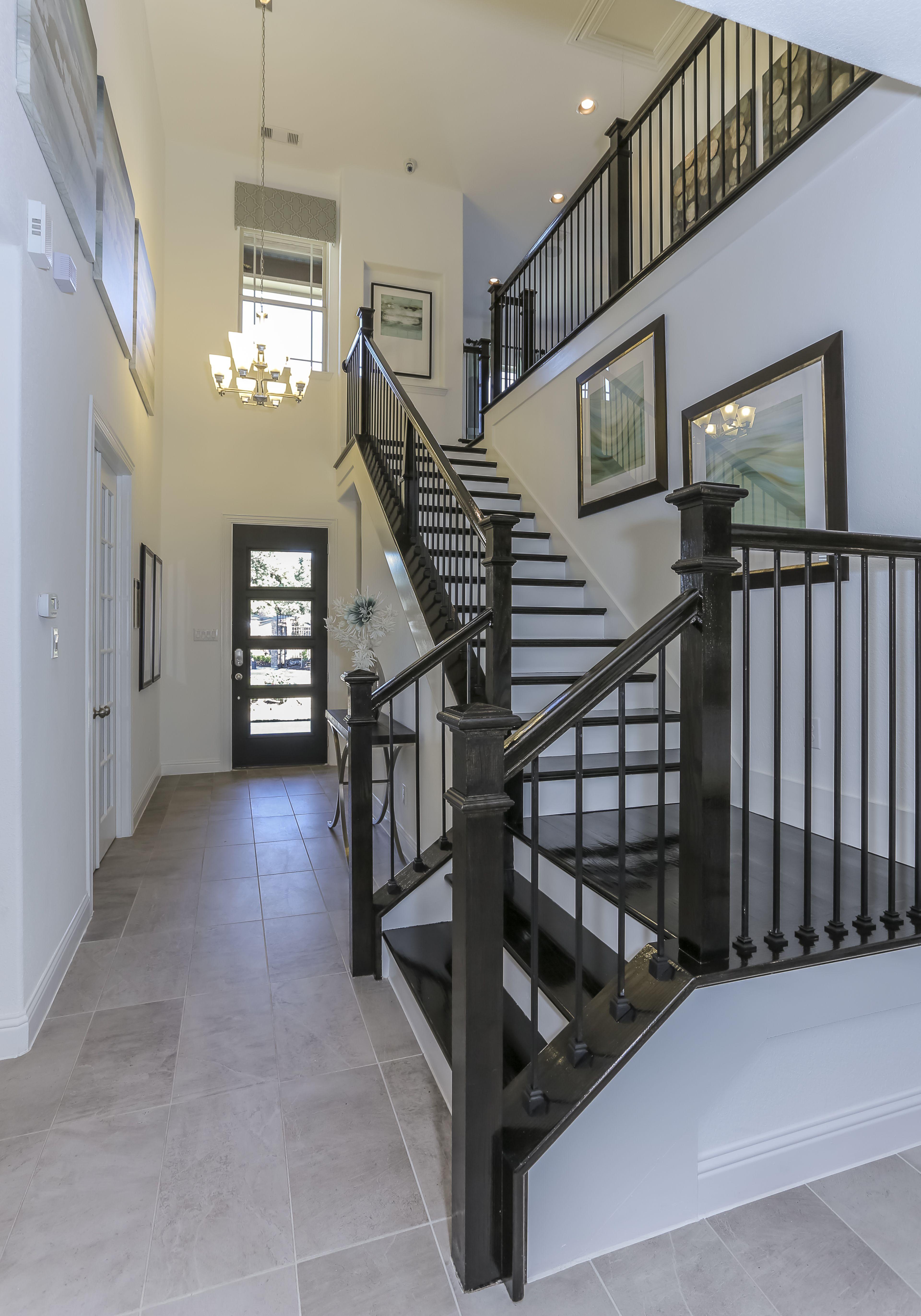 Gehan Homes Stairway - Black Hardwood Tread, White Risers ...