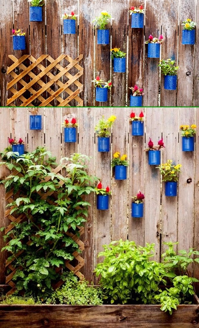 Tin can planter pot garden fence decor 20 fence decoration Outdoor fence art ideas