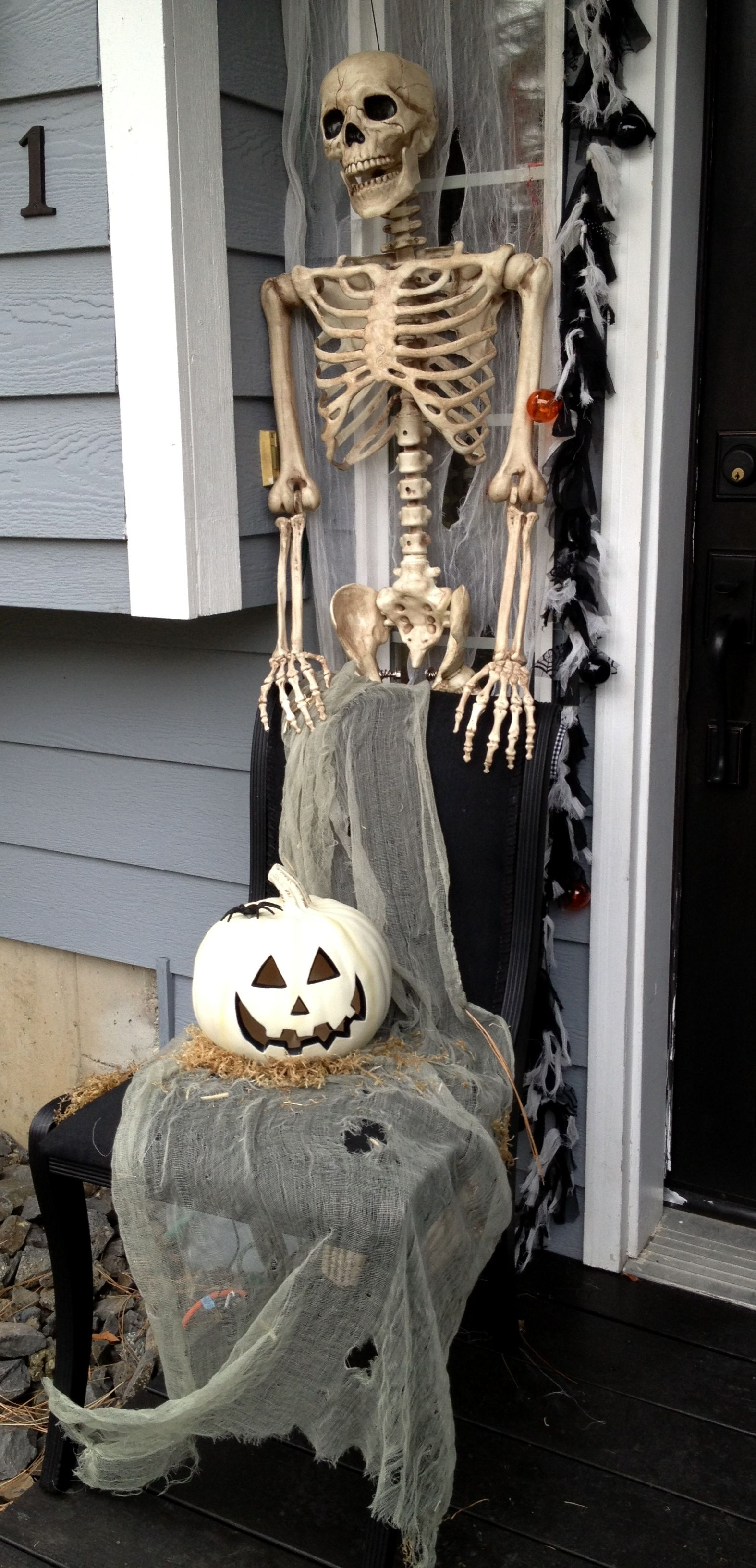 Stood my skeleton in the corner ( had an old chair I sprayed the - Front Door Halloween Decoration Ideas