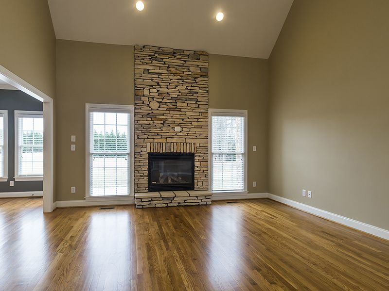 Floor to ceiling stacked stone fireplace flanked by