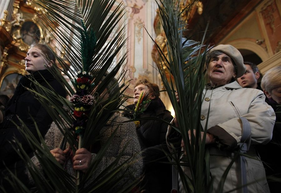 Women hold palm fronds as they take part in a Mass celebrating Catholic Palm Sunday at Saint Anna church in Warsaw, Poland, April 1.