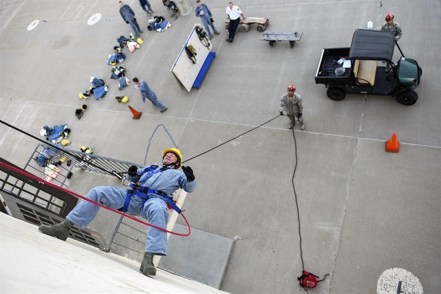 Air Force Lt Col Garrett Stumb rappels down a 3-story building