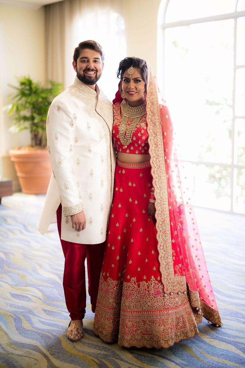 Bride And Groom In Traditional Indian Wedding Attire Bride In Lehnga And Groom In Sherwani Indian Wedding Couple Indian Wedding Wedding Outfits For Groom