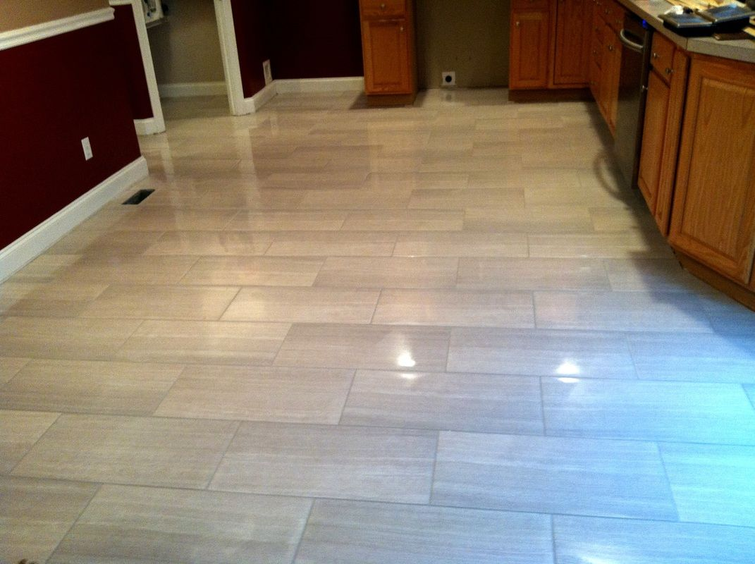 Modern kitchen floor tile by link renovations for White tile flooring ideas