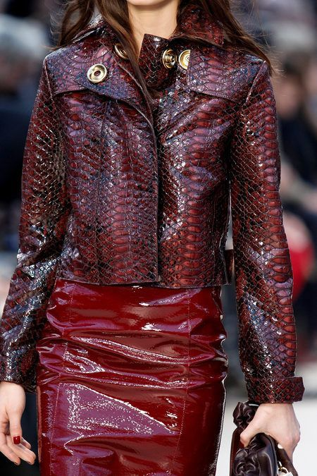 96ea76638bd2 Model rocks boxy black and red snakeskin jacket with red pencil skirt.. DIY  the
