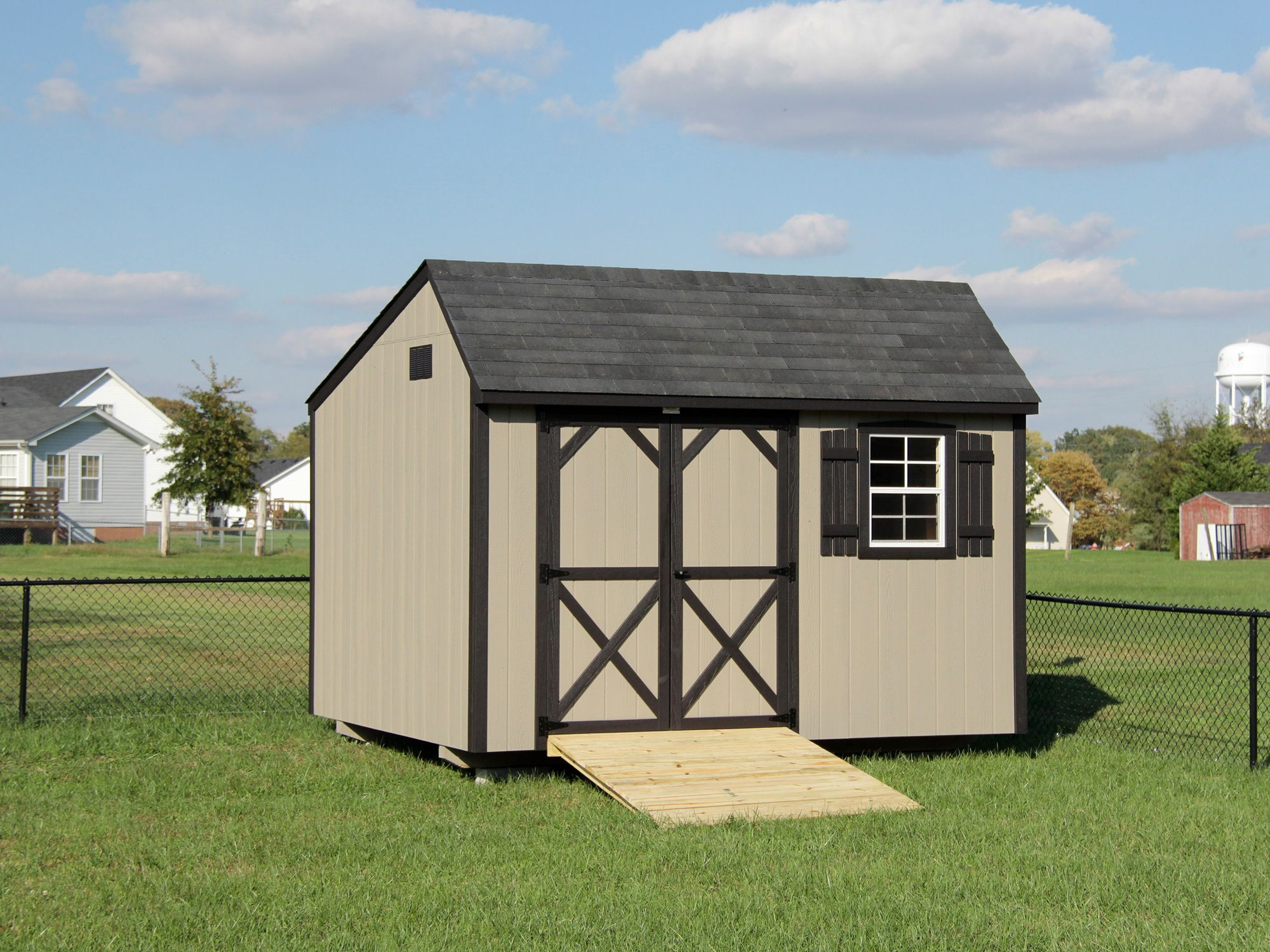 small saltbox quaker style storage shed in the backyard quaker