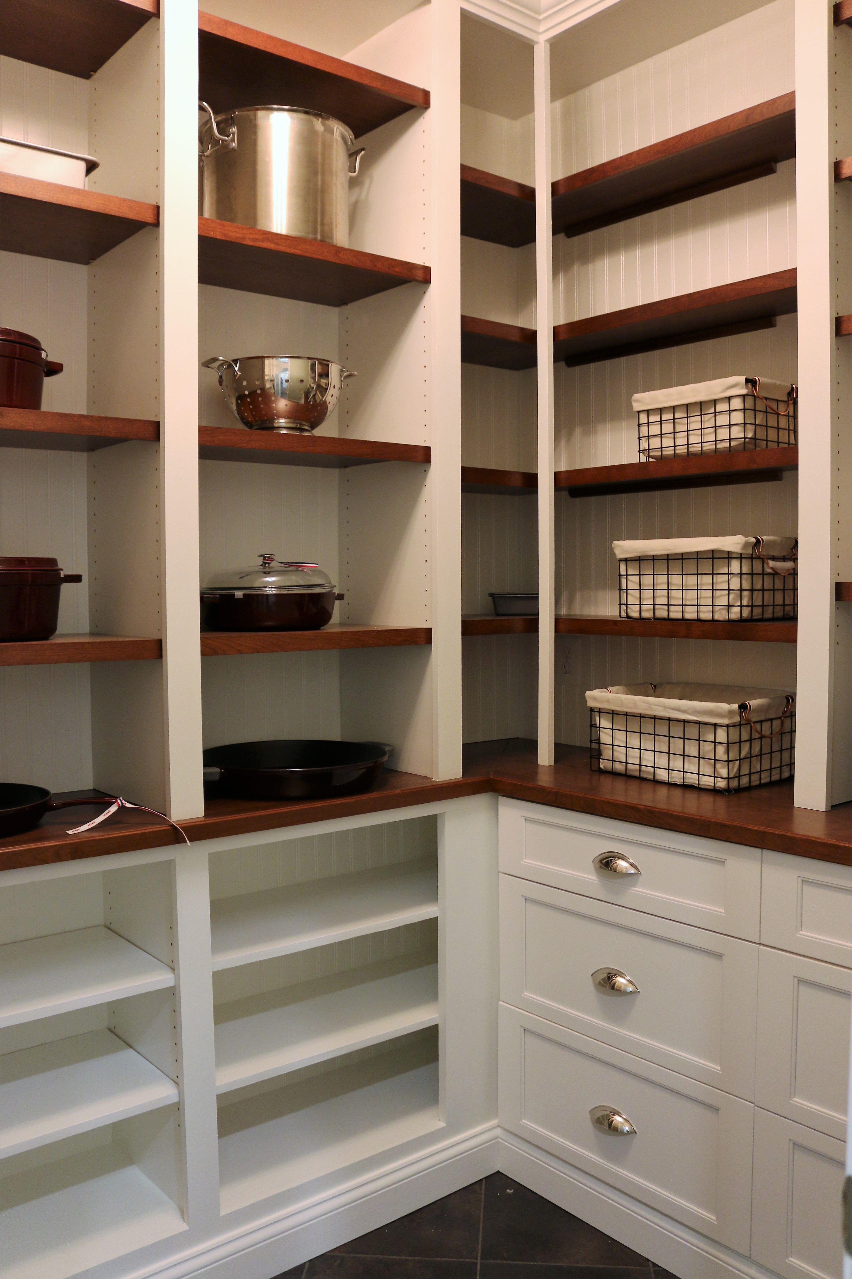 A Newly Expanded Pantry With More Storage Space Created By Adding