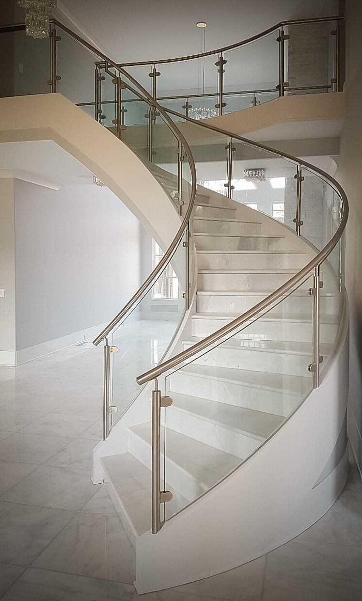 Modern Curved Staircase With Stainless Steel And Glass Railings For