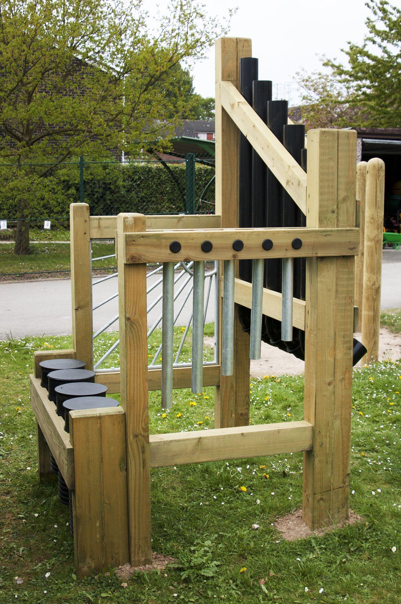 outdoor sound station installed into grass playground