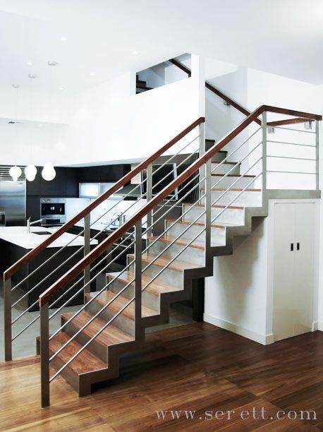 Stainless Steel Stair With Walnut Treads And Handrail. Serett Metalworks