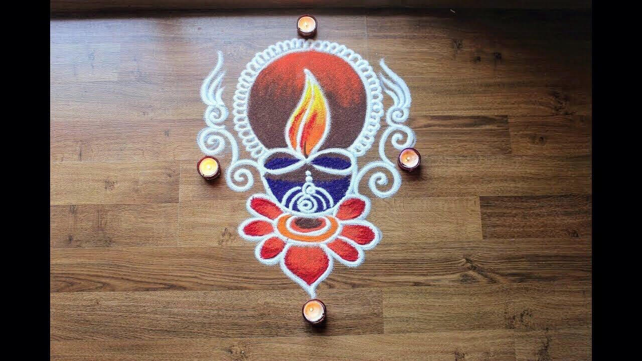 Simple freehand Diwali special rangoli designs with