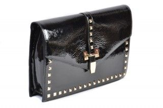 Black patent studded clutch or shoulder bag. Dress it up or down for the perfect day or evening look.