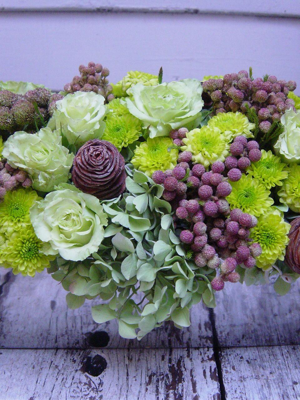 Green and purple reception wedding flowers decor