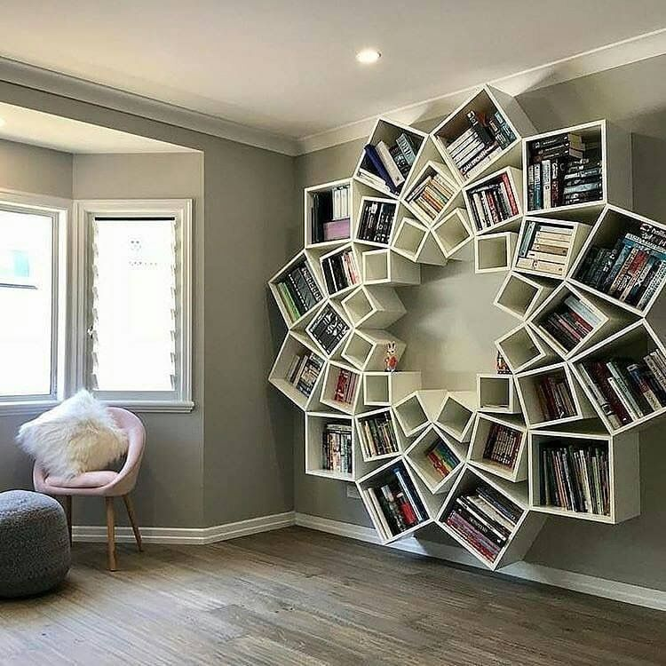 LOVE this flower book shelf display for Adriana's future ...