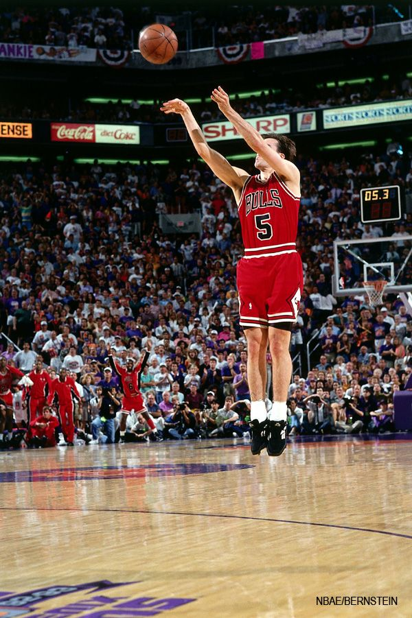 b88671b4620 John Paxon mid-air while shooting his game-winning three-point shot in Game  6 of the 1993 NBA Finals to give the Bulls their 3rd straight NBA Title.