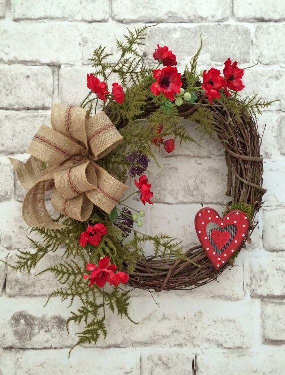 Simple elegant Valentine's Day grapevine wreath with burlap bow.