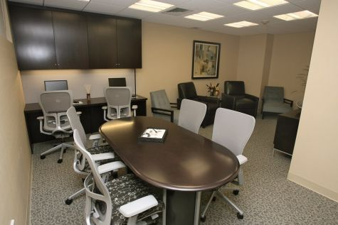 """It is designed for brain tumor patients and their families to spend time together in optimum comfort in a """"living room"""" setting while receiving treatment. The facility also includes the head neuro-oncologist's office, staff offices, and a conference room/library with educational research materials for families to explore medical options."""