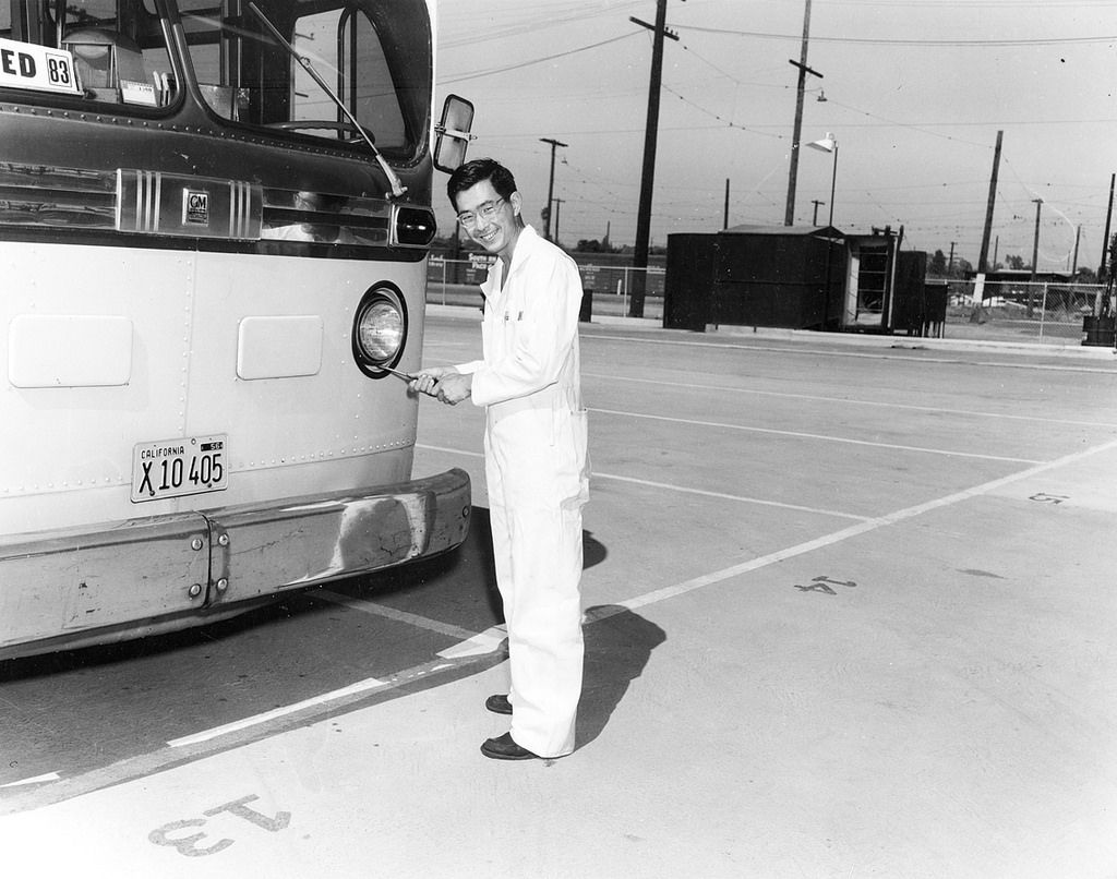 Metropolitan Coach Lines Employee with a Bus at the West Hollywood Division circa 1955.